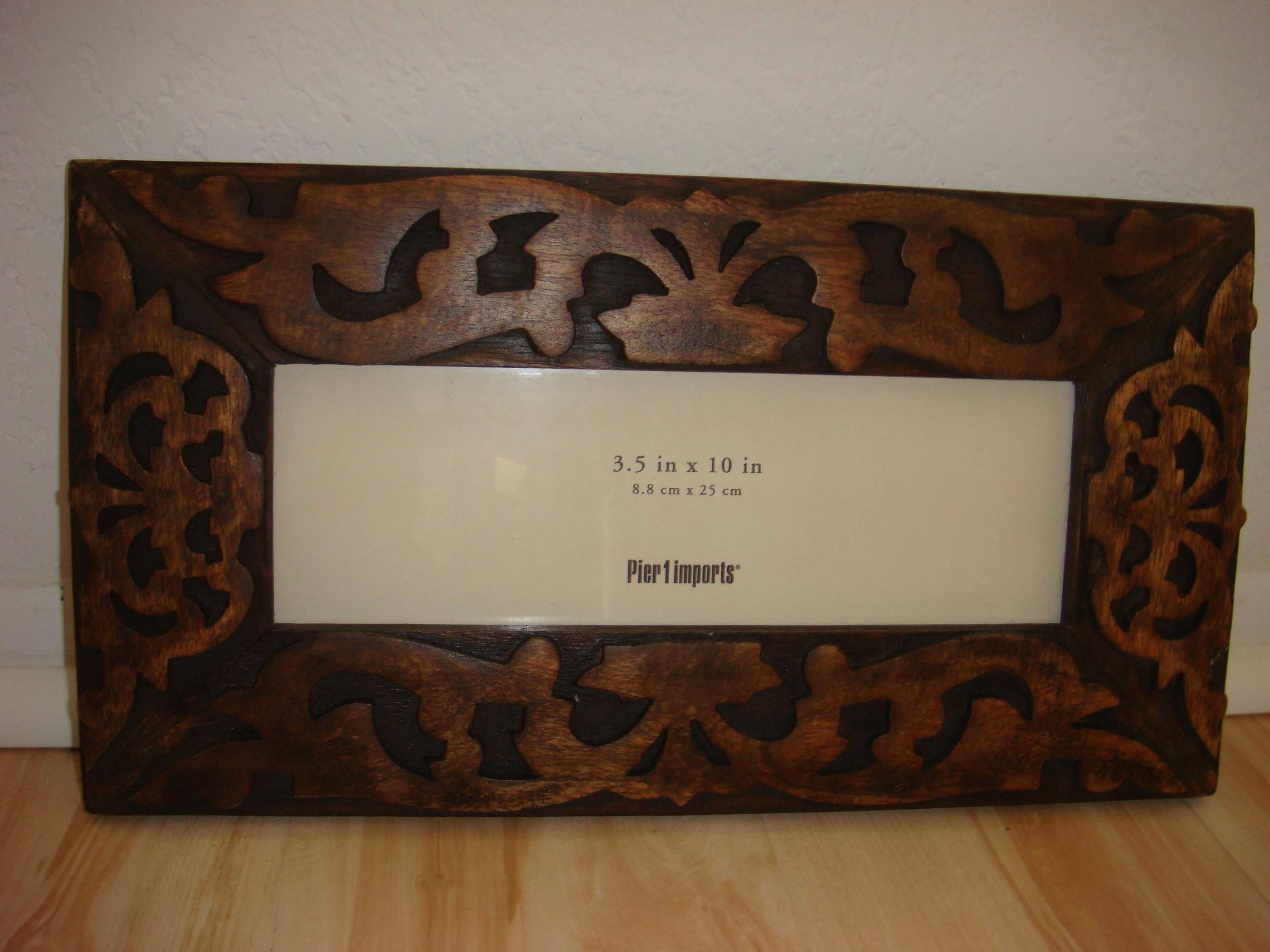 Richly carved photo frame